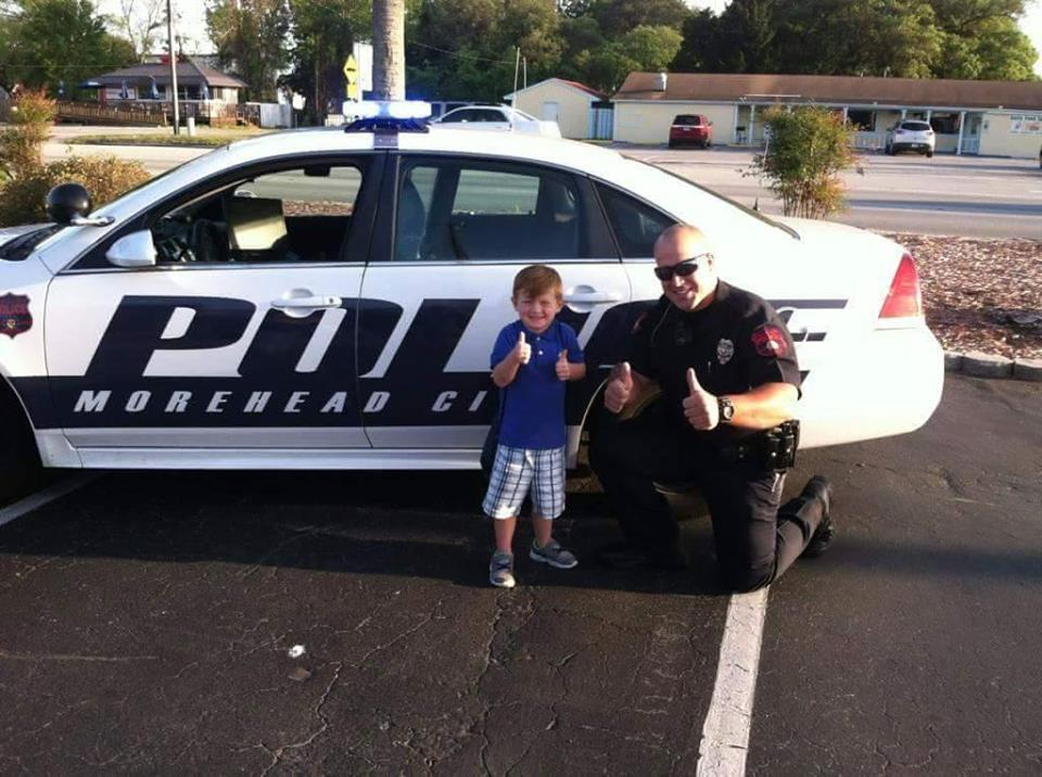 Police Officer with Boy Thumbs Up